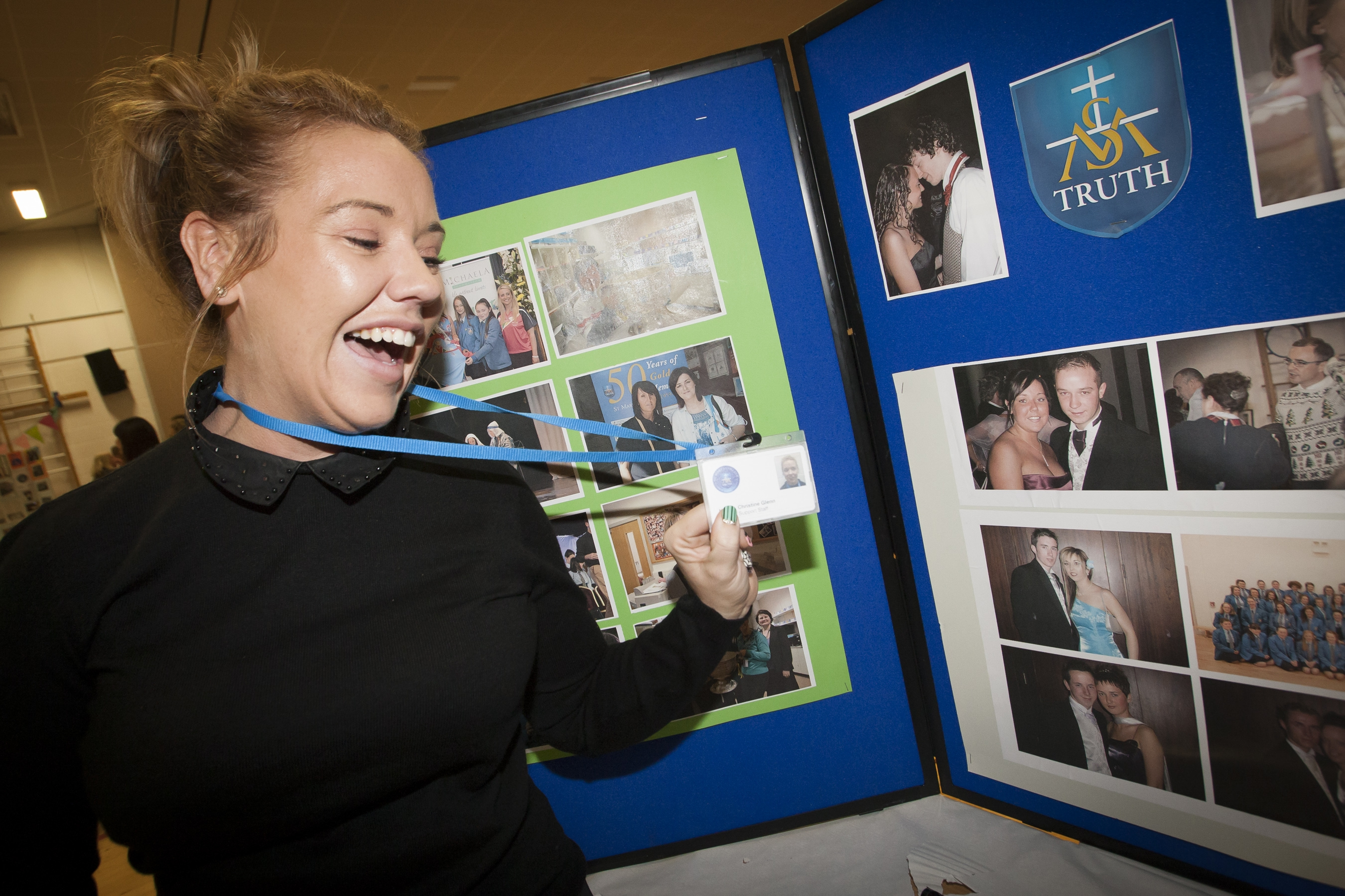 Christine Glenn finds an old photo of herself at the St. Mary's College 60th Anniversary Exhibition on Friday.