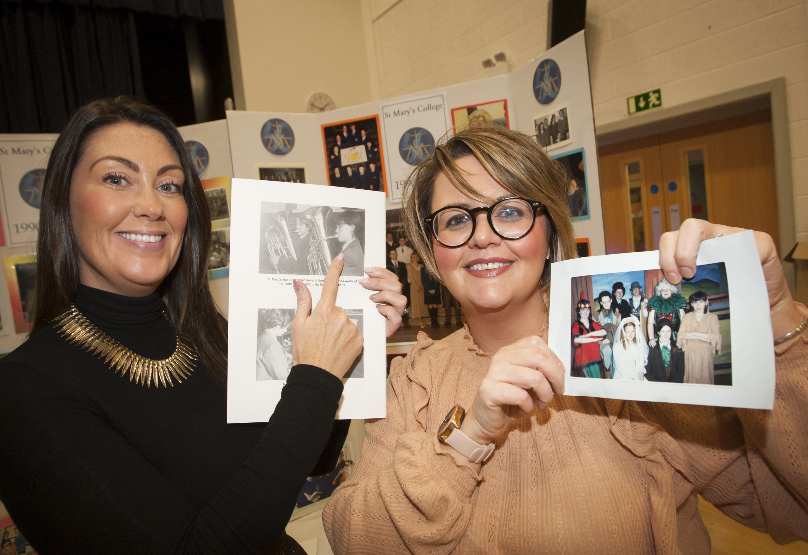 Heather McGee, past pupil/teacher and Clare Mankoo, past pupil find old images of themselves at Friday's exhibition.