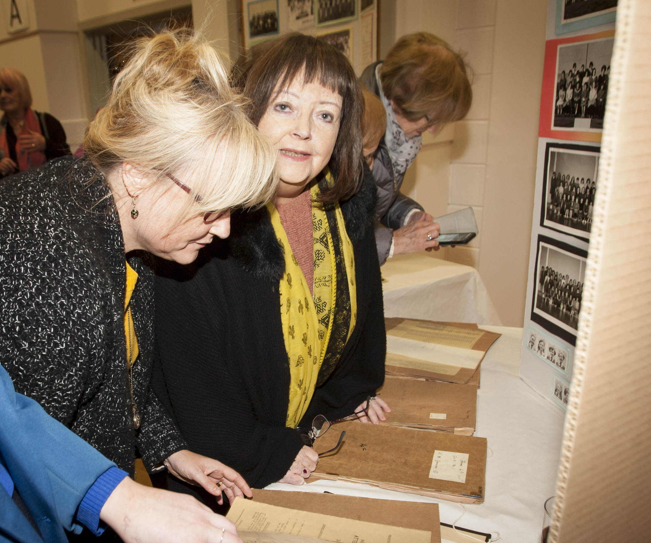Past pupils looking through some of the old school rolls on Friday.