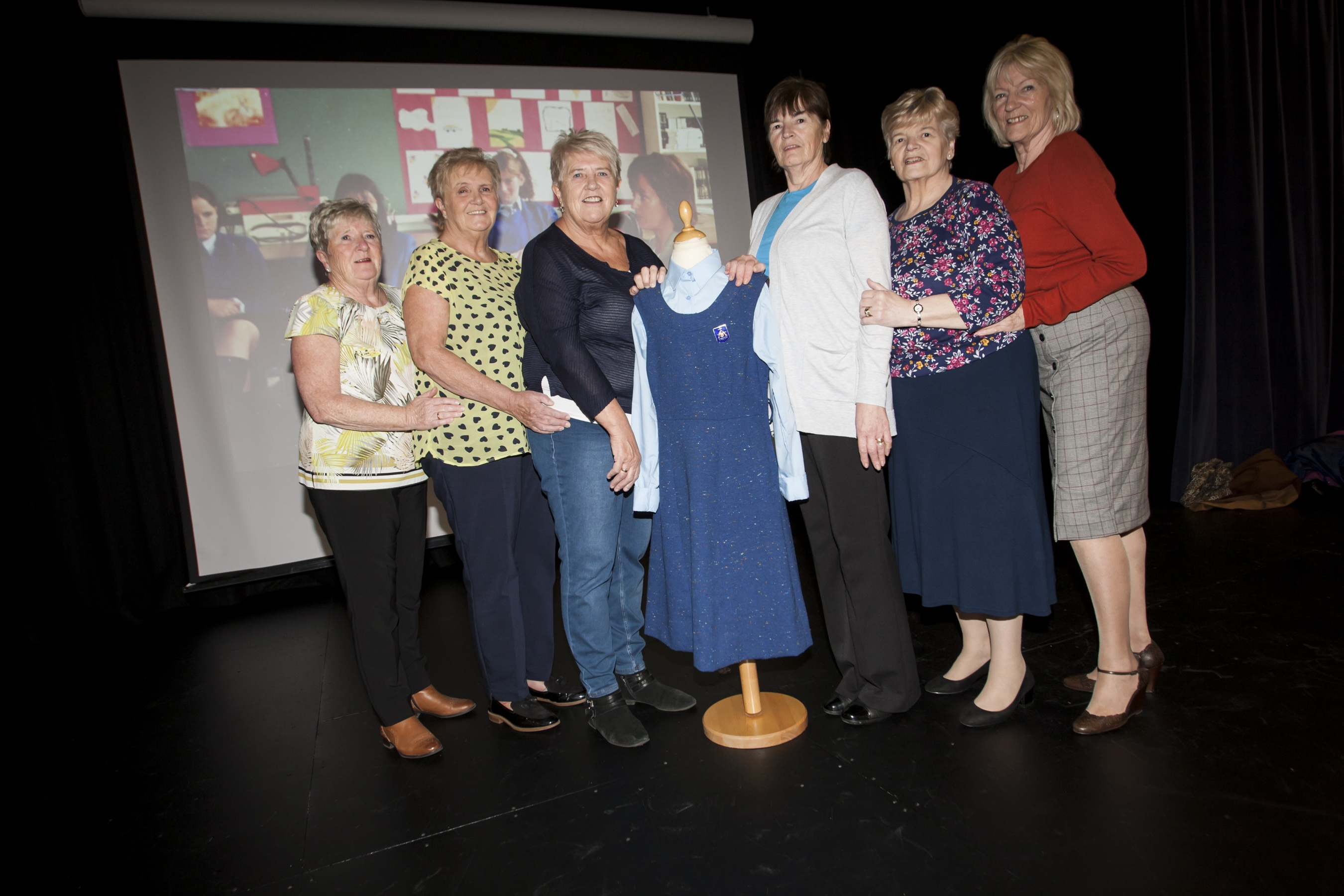 The Ferry sisters (left), Betty, Bridie and Maeve and the McGrory sisters (right), Marie, Madeline and Jean, all past pupils of St Mary's, pictured at Friday's exhibition.