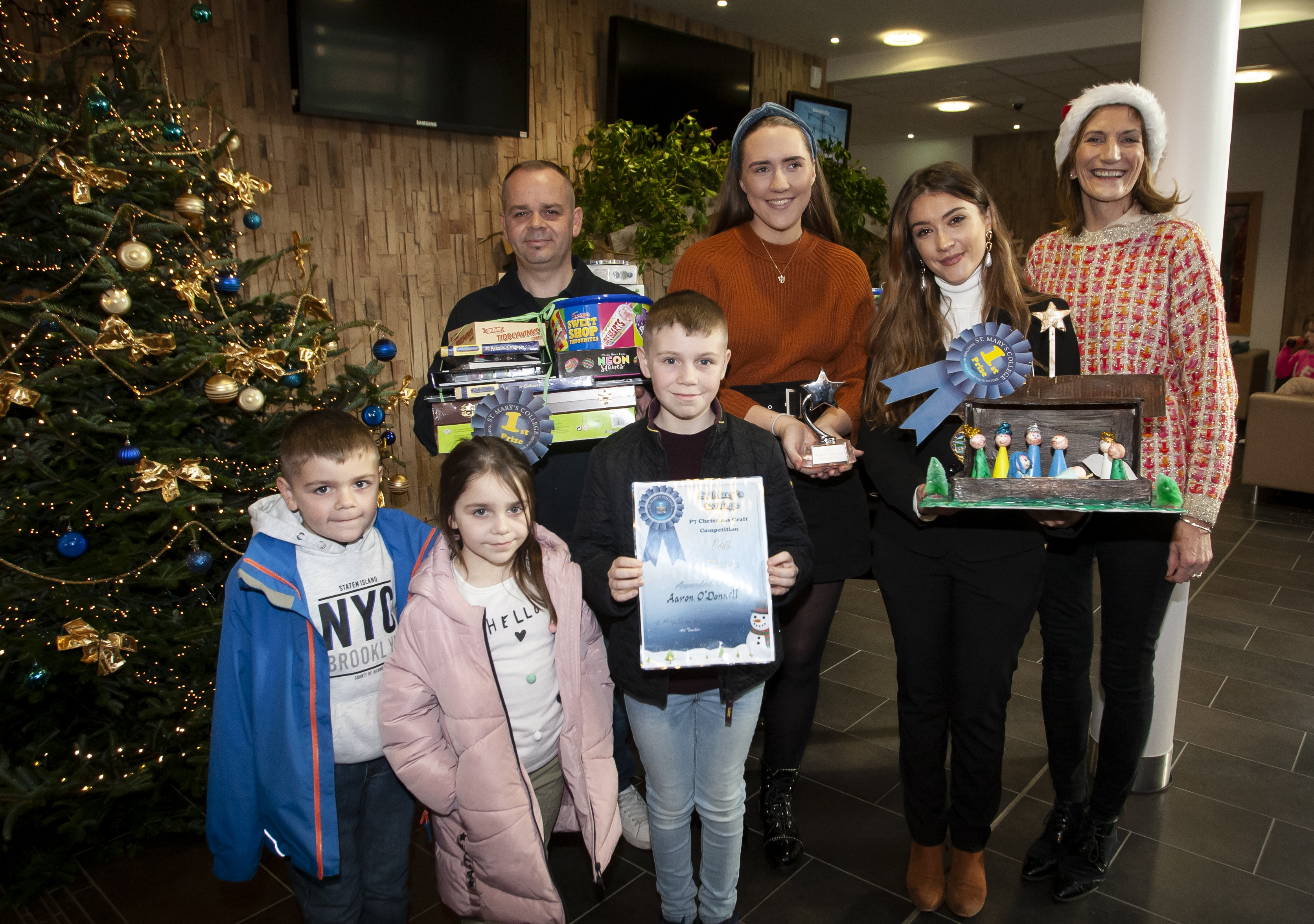 Master Aaron O'Donnell, winner of the St Mary's College Annual Christmas P7 Craft Competition, pictured on Saturday receiving his award from the Deputy Mayor, Councillor Cara Hunter. Included are Aaron's dad Terry, and siblings Oisin and Aoife. On right is Mrs. Marie Lindsay, Principal, St. Mary's College. (Photos: Jim McCafferty Photography)