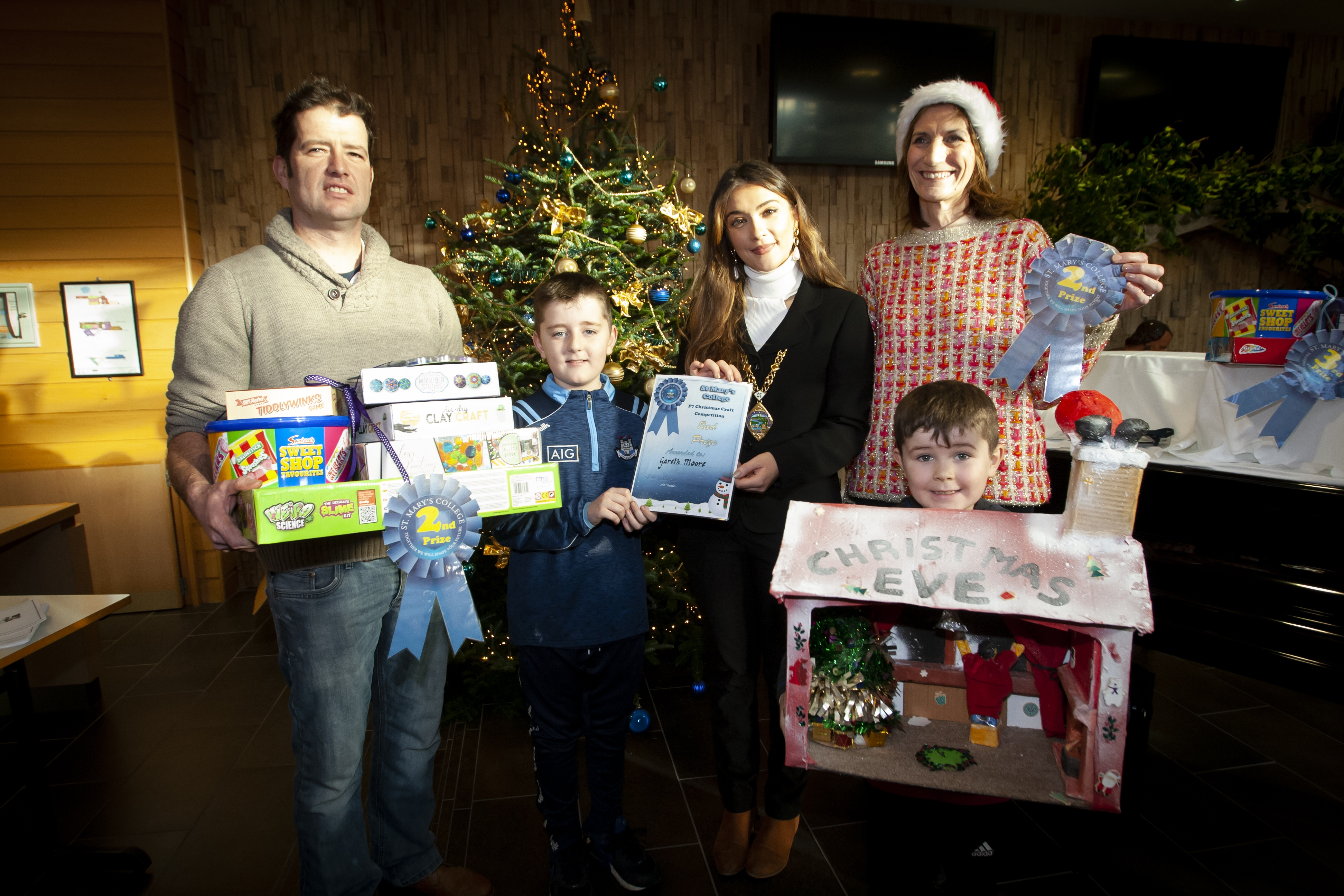 Gareth Moore, second in the St Mary's College Annual Christmas P7 Craft Competition, pictured on Saturday receiving his award from the Deputy Mayor, Councillor Cara Hunter. Included are Gareth's dad Carl and brother Lee. On right is Mrs. Marie Lindsay, Principal, St. Mary's College.