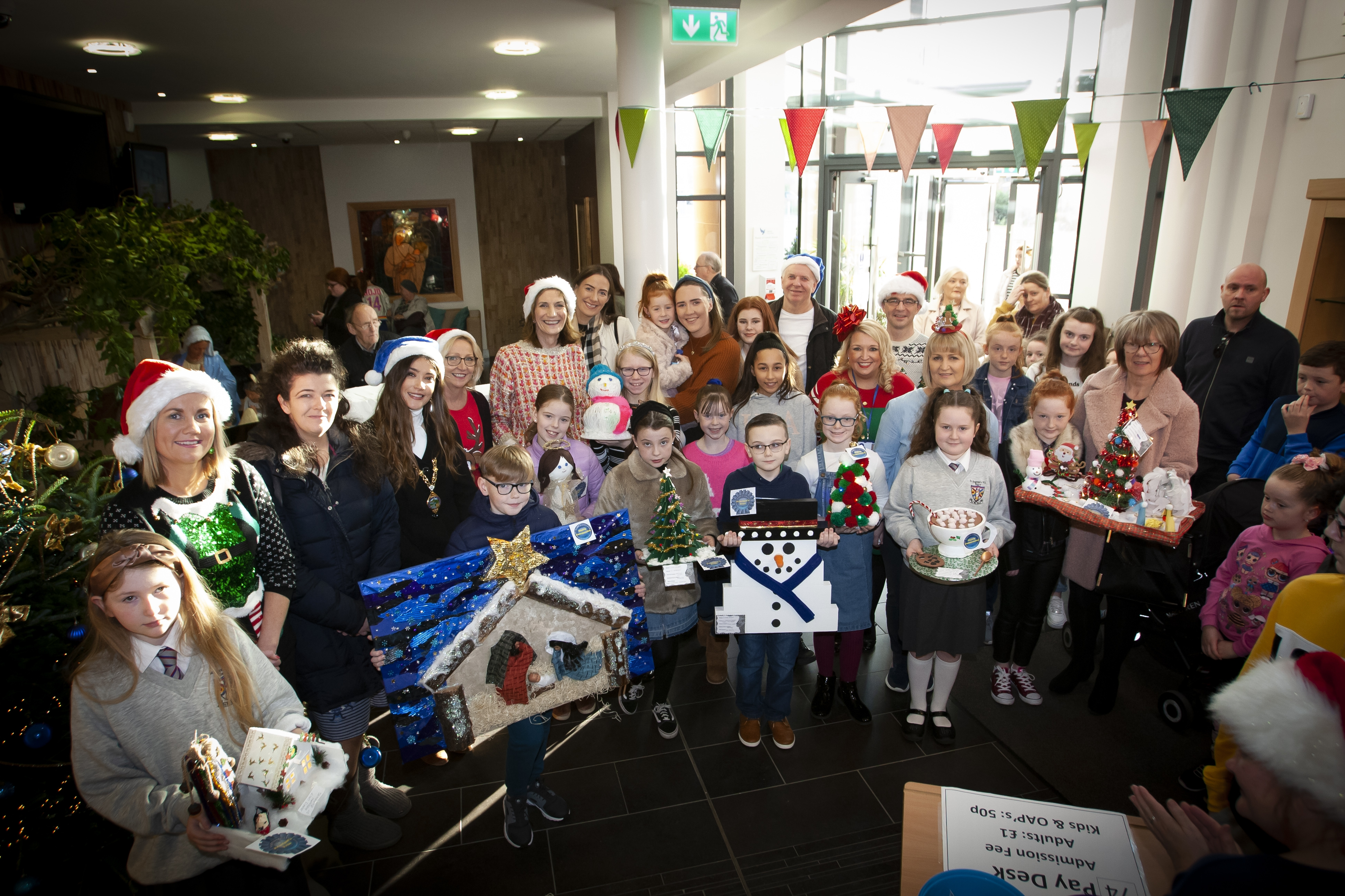 Group of prizewinners, parents, staff and the Deputy Mayor, Cara Hunter pictured at Saturday's St. Mary's College Annual Christmas Craft Fair.
