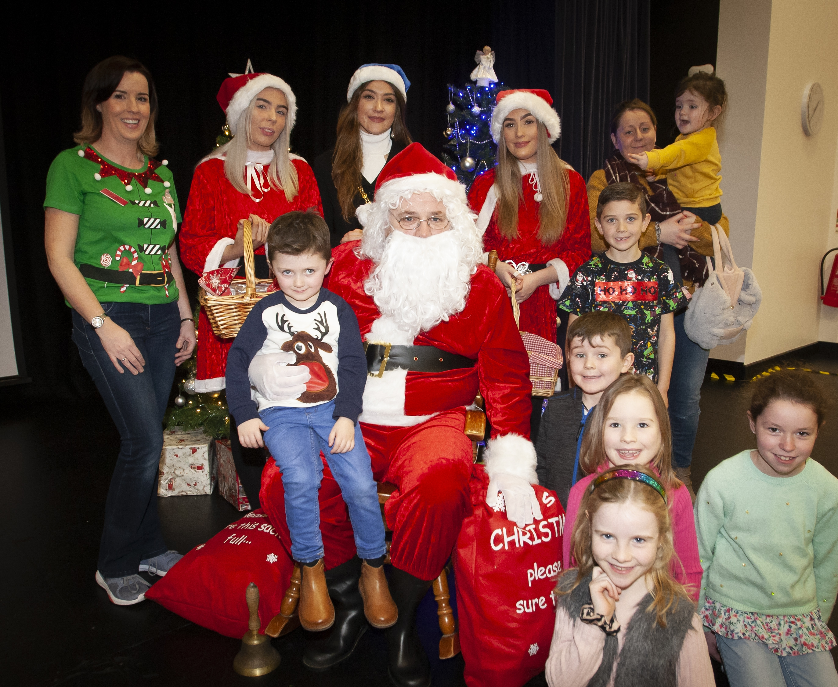 Santa Claus and the Deputy Mayor, Councillor Cara Hunter pictured with some of the children who attended Saturday's St. Mary's Annual Christmas Craft Fair at the school.