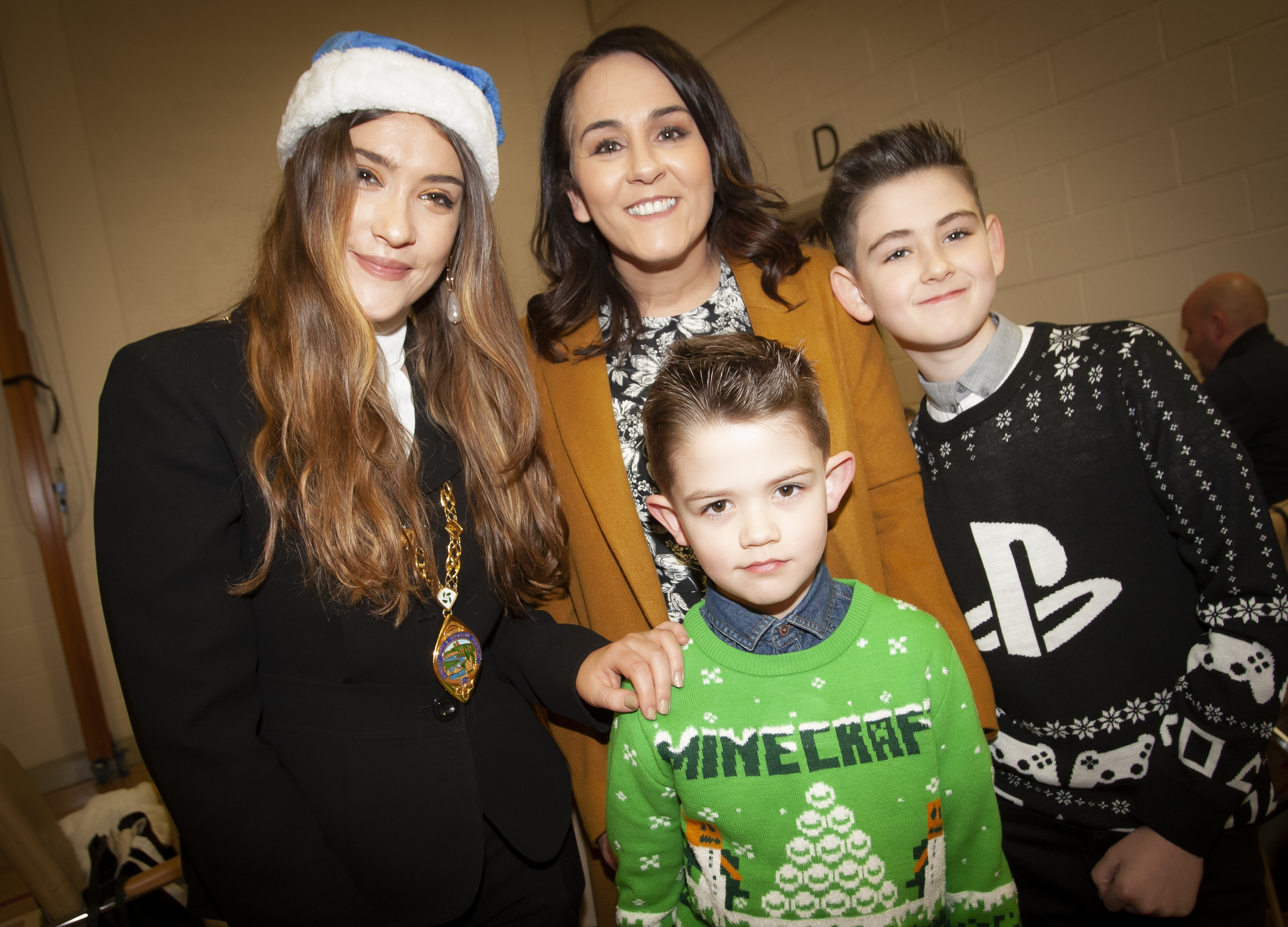 Deputy Mayor, Cara Hunter pictured during Saturday's St. Mary's Annual Christmas Craft Fair with senior teacher Yvonne Connolly and her sons Caiden and Charlie.