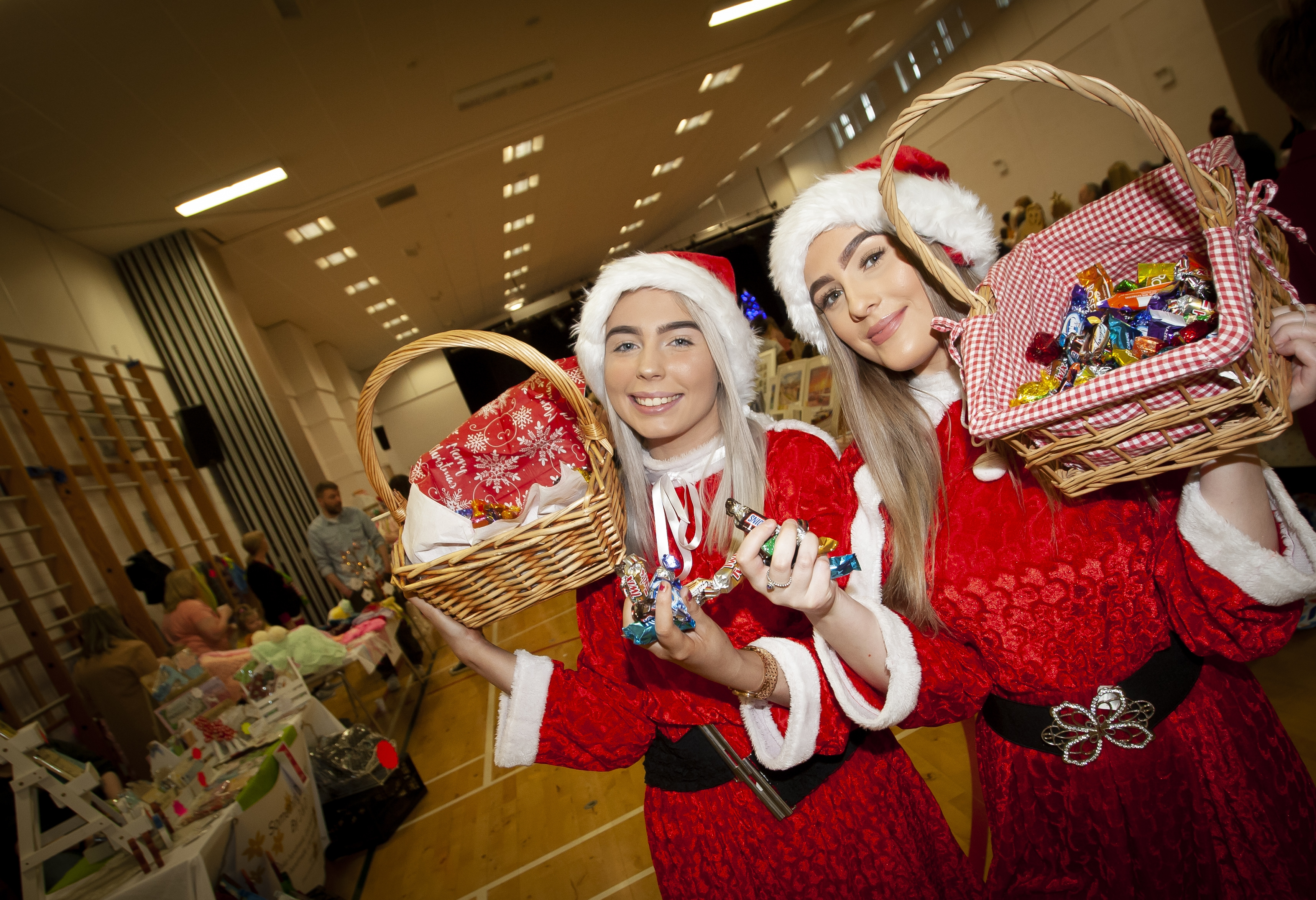 SAnta's Little Helpers Kellie Maxwell and Oshiana McAdams pictured handing out sweets during Saturday's St. Mary's Annual Christmas Craft Fair at the school. (Photos: jim McCafferty Photography)