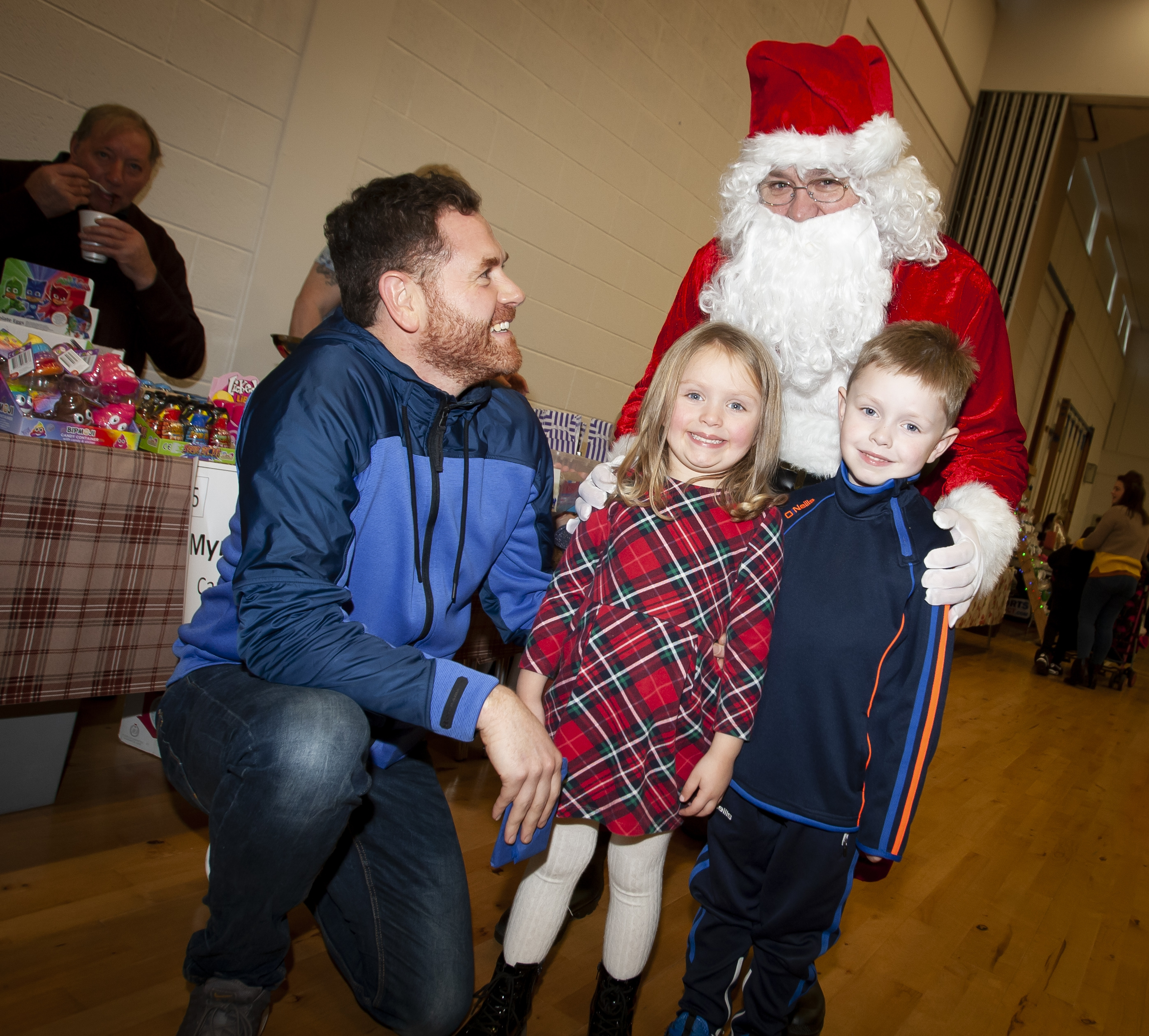 Mr. Conor Lynch (teacher) pictured chatting to Santa on Saturday at St. Mary's College. Included are Harry (5) and Anna (4).