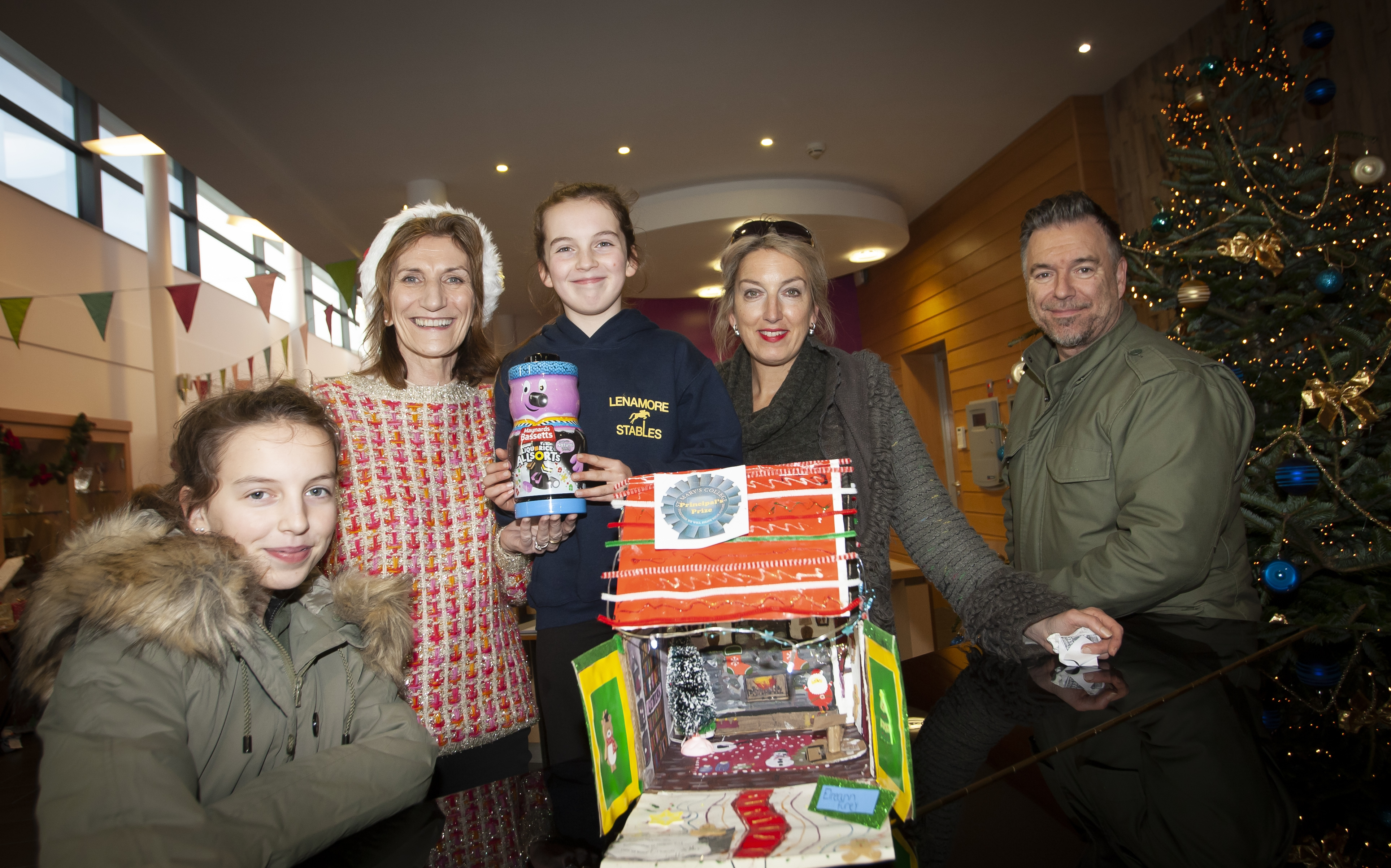 Miss Eireann Furey (10) pictured receiving her prize from Mrs. Marie Lindsay, Principal, St. Mary's College during Saturday's Craft Fair at the school. Included are Eireann's parents Sean and Michelle and sister Tara (14).