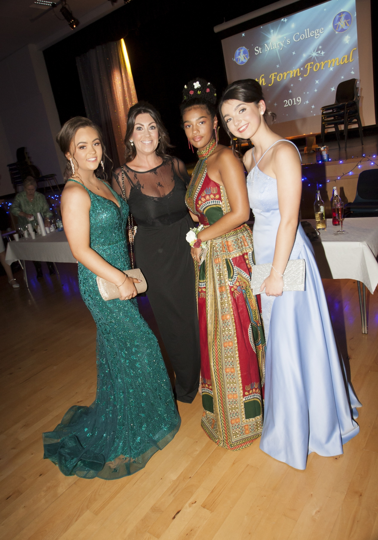 Mrs. McGee pictured with Deirbhile Herron, Ellen Glackin and Eimear Cregan at the  St. Mary's College Annual Formal on Thursday night last. (Photos: Jim McCafferty Photography)