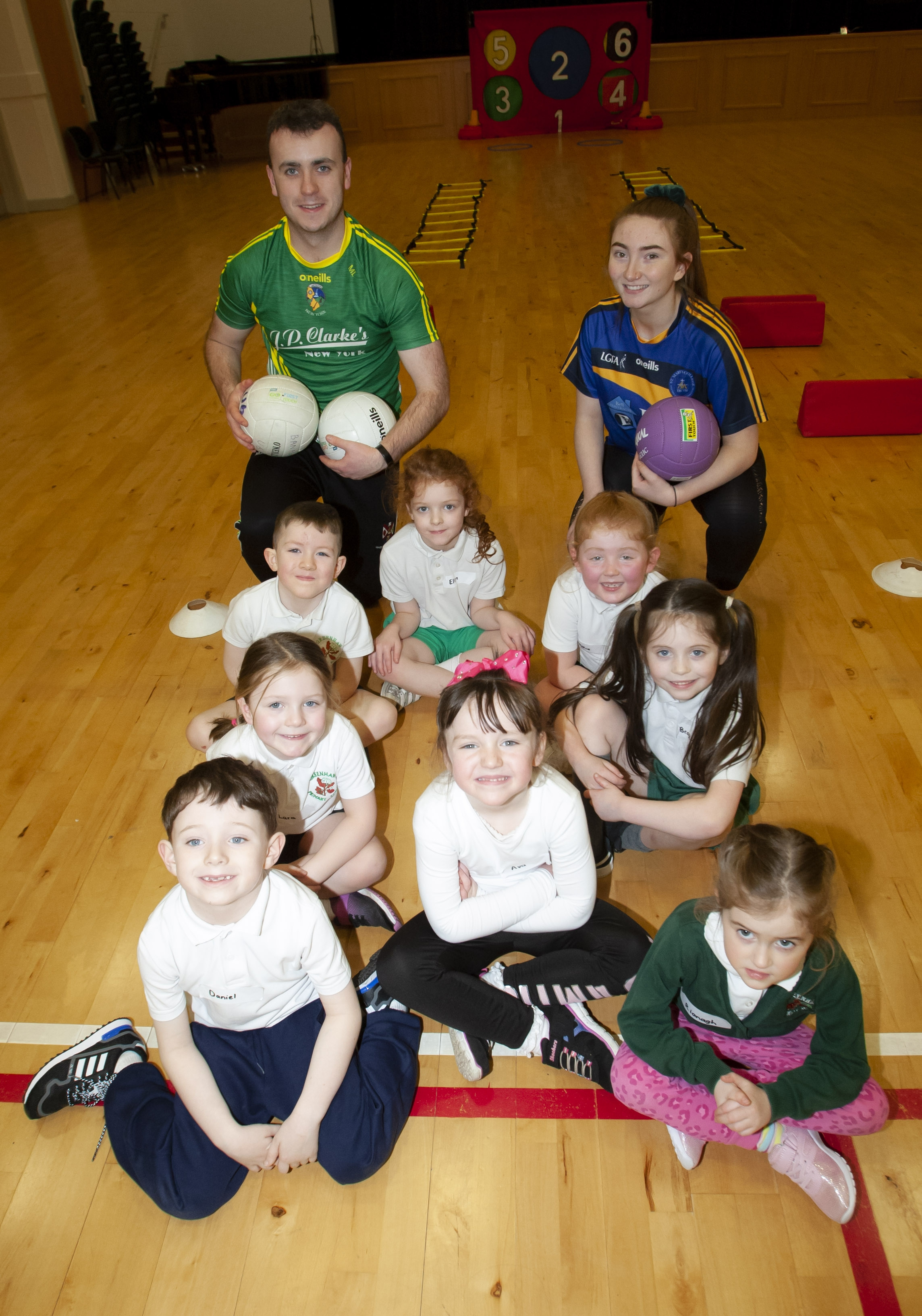 P2 pupils from Greenhaw PS pictured with Martin Lynch and Megan Doherty at the start of Friday's Health Promotion Week Primary Schools event in St. Mary's College.